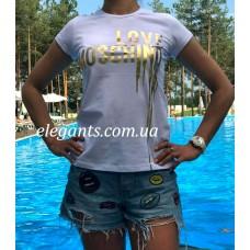 Где купить женскую футболку MOSCHINO (ITALY) белого цвета? Заказывайте на сайте интернет магазина одежды «Элегант» Сумы (Украина) - каталог одежды Москино (Италия) коллекции моды (смотреть онлайн видео и фото девушки топ модели)